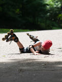 Little rollerblader takes a tumble Stock Photos