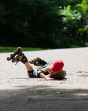 Little rollerblader takes a tumble Royalty Free Stock Image