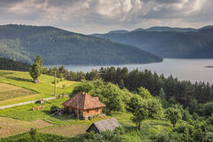 Little romanian house on the the shore of Lake Bicaz Stock Images