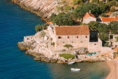 Little romantic inlet and old house Stock Image