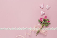Little rose and hearts with lace border on a pink background. Va. Lentine`s Day background. Space for text, top view stock photo