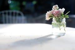 Little roses. Little roses on the table ann make the dinner different Stock Images
