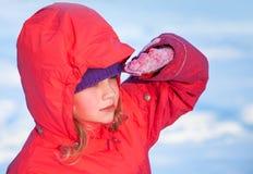 Little ruddy nice girl in winter outwear Stock Photos