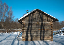 Little rural bathhouse in the snowy village Stock Photos