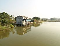 Little rural houses over water, Nam Sang Wai, HK Royalty Free Stock Image