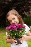 Little Russian Girl Hold Bouquet Purple Flowers Outdoor. royalty free stock photography
