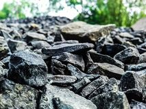 Little black stone and green background stock photography