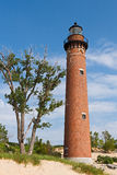 Little Sable Point Light. The lighthouse at Michigan's Little Sable Point  rises from sand dunes overlooking Lake Michigan Stock Photo