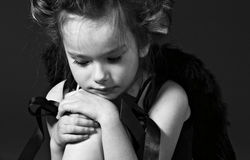 Little sad angel. Monochrome portrait of the little sad girl stock photography