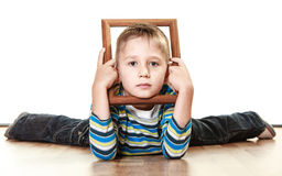 Little sad boy child framing his face Royalty Free Stock Images