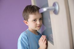 Little sad boy overhears fight of his parents Stock Photography