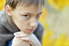 Little sad boy in park Royalty Free Stock Photos