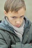 Little sad boy. Portrait of a little sad boy in autumn park Stock Photo