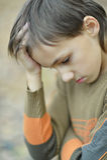 Little sad boy. Portrait of a little sad boy in autumn park Stock Photography