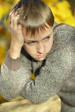 Little sad boy. Portrait of a little sad boy in autumn park Royalty Free Stock Photography