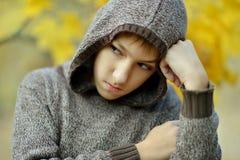 Little sad boy. Portrait of a little sad boy in autumn park Royalty Free Stock Photo