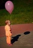 Little sad girl with balloon. Photo of little sad girl with balloon Stock Images