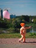 Little sad girl with balloon. Photo of little sad girl with balloon Royalty Free Stock Image