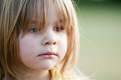 Little sad girl Stock Photo