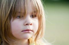 Little sad girl Stock Photo