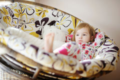 Little sad girl in pajamas on sunny morning Royalty Free Stock Photo