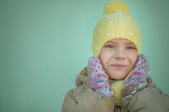 Little sad girl in pink coat Stock Photos