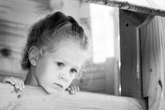 Little sad girl on the playground. Black and white series Stock Photo