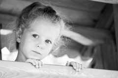 Little sad girl on the playground. Black and white series Royalty Free Stock Image