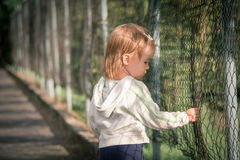 Little sad girl in poor city. Little sad girl on walk in poor city Royalty Free Stock Images
