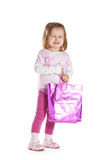 Little sad girl with shopping bag Royalty Free Stock Photos