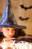 Little sad girl in witch costume, halloween Royalty Free Stock Image