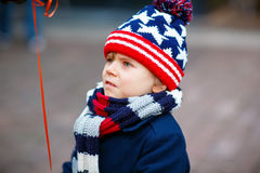 Little sad kid boy crying outdoors on christmas market. Little cute kid boy crying on Christmas market in Germany, outdoors. Sad child Stock Images