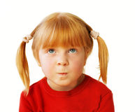 Little sad redhead girl Stock Photos