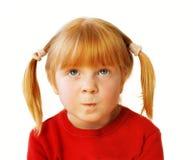 Little sad redhead girl. Little girl, emotional portrait on white background Stock Photos