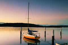 Little Sailing Boat at Woy Woy at sunrise Stock Photos