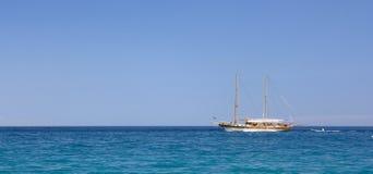 Little sailing yacht at beautiful day. Turkey, Kemer. Captured with polarized filter,  ISO 100, RAW>TIFF>JPEG 1 Stock Image