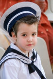 Little sailor. Boy with snot in his nose dressed in navy costume Royalty Free Stock Images