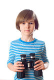 A little sailor holds black binocular Stock Images