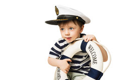 Little sailor keeps lifebuoy. Little sailor Captain Hat keeps lifebuoy Royalty Free Stock Photography