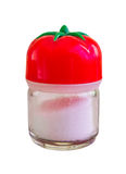 Little saltshaker with a tomato top full with salt on a white background.  royalty free stock image