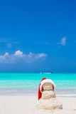 Little sandy snowman with red Santa Hat on white Royalty Free Stock Images