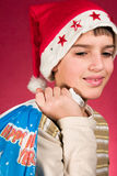 Little santa. Cute little boy and santa claus hat Royalty Free Stock Image