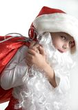 Little santa. Small boy with santa's hat and bag full of gifts Royalty Free Stock Images