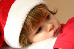 Little Santa. Kid wearing Santa's hat on  warm tone background Royalty Free Stock Photo