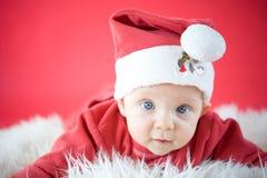 Little Santa. Cute baby in Santa hat Stock Images
