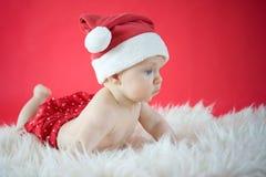 Little Santa. Cute baby in Santa hat Royalty Free Stock Image