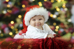 Little santa baby with christmas hat Stock Image