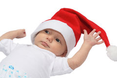 Little Santa Claus. Baby in the christmas cap Royalty Free Stock Photos