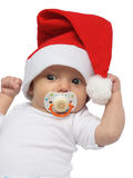 Little Santa Claus. Baby in the christmas cap Royalty Free Stock Image