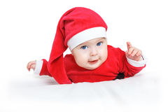 Little Santa Claus. Crawling baby in Santa Claus costume Royalty Free Stock Image
